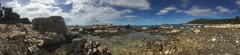 Lokrum Island is full of rocks and beautiful game of thrones artifacts this is a panoramic view of the edge of the island where the sea crashed against the rocks in Dubrovnik Croatia