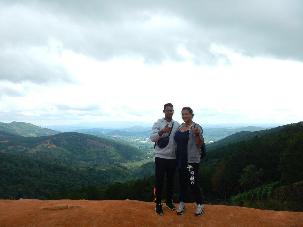 standing on the edge of a cliff in Vietnam whilst on a motorbike tour in Da Lat. Look at that view