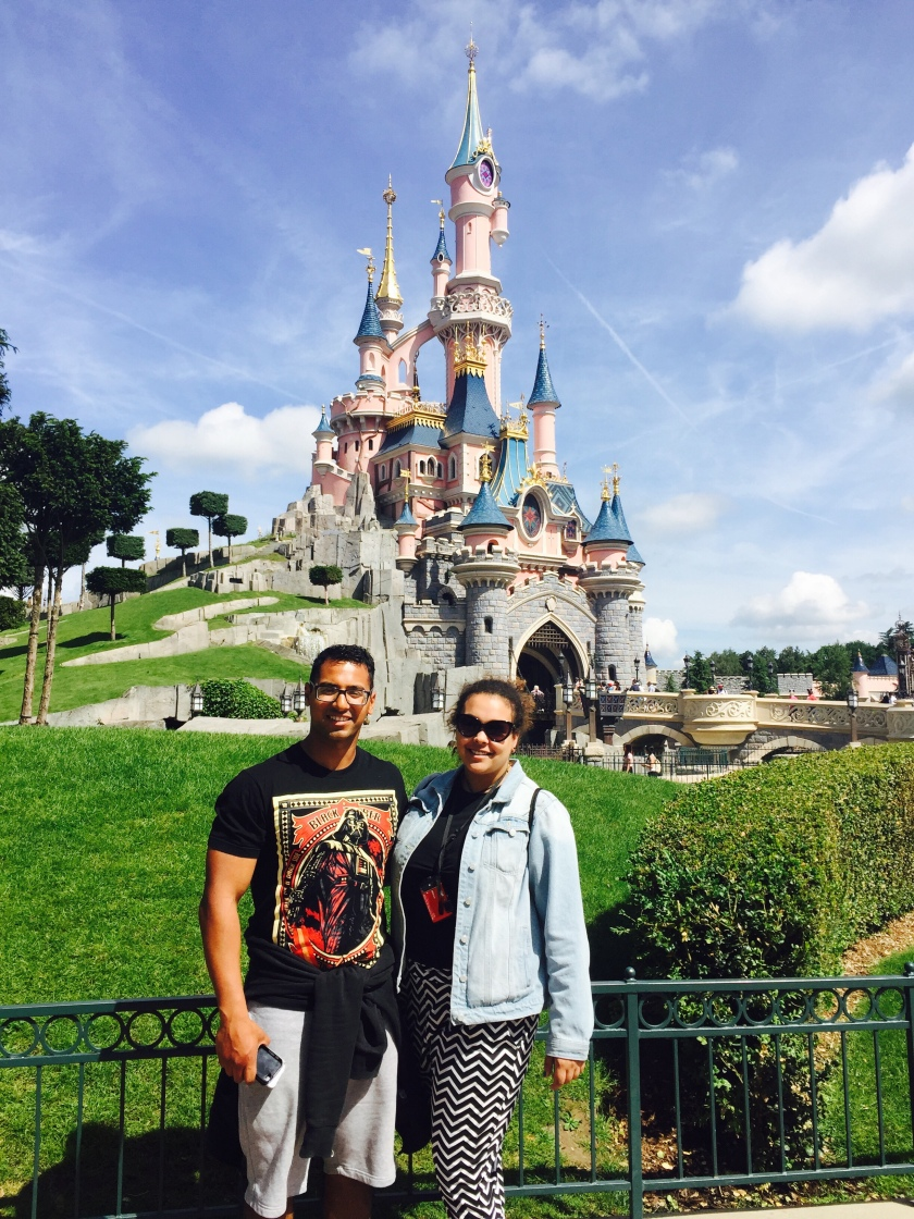 Jemma and Irfan in front of the disney Land castle in paris