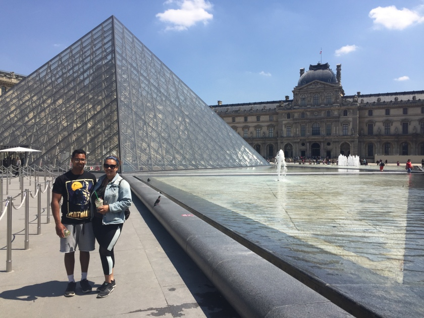 Irfan Chaudhary and Jemma Reid stood outside the Lourve museum in Paris