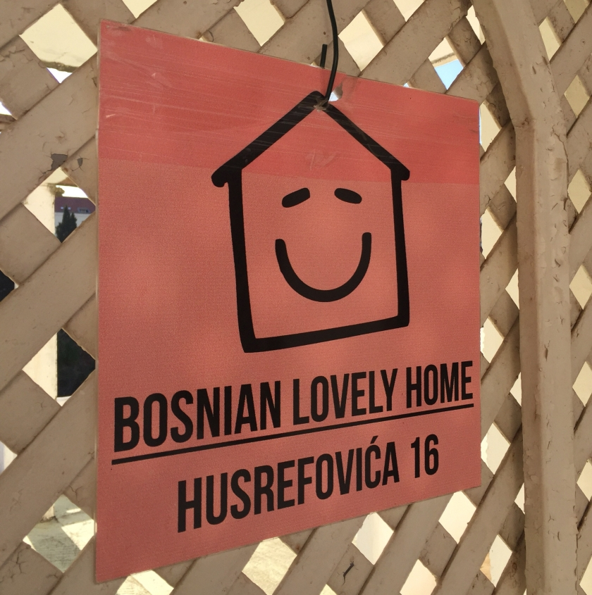 "The entrance sign to the hostel reads ""Bosnian Lovely Home Husrefovica 16"""