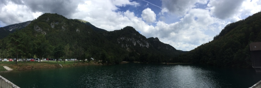 A panorama shot whilst on horseback of the mountains and the small pond / rive up in the mountains of Bled in Slovenia