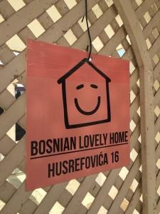 Bosnian hostel sign on the front gate entrance pink sign