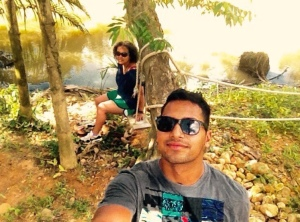 Jemma and irfan outside selfie by the river on the swing in Thailand