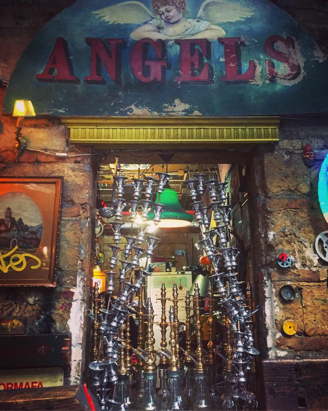 "Szimplas shisha pipes under a vintage ""angels"" sign"