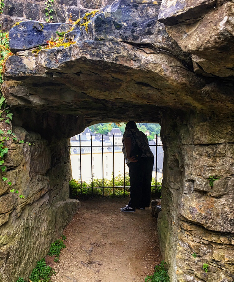 A woman looks over the town from the casemates