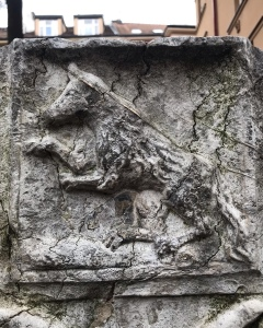 Grave stone wolf symbol at old Jewish cemetery in Prague