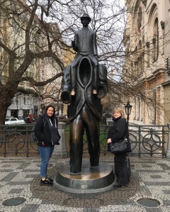 Statue of man on headless giants shoulders in Jewish quarter Prague