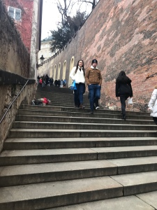 People on the steep stairs in Prague